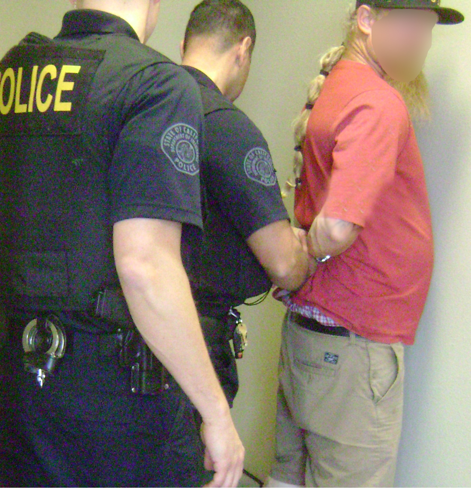 Local law enforcement detaining a suspect to protect SWIFT investigators during the citation process